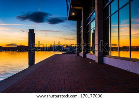 Sunset reflecting in a building on the waterfront in Fells Point, Baltimore, Maryland. - stock photo