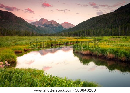 Sunset reflection in the Uinta Mountains, Utah, USA. - stock photo