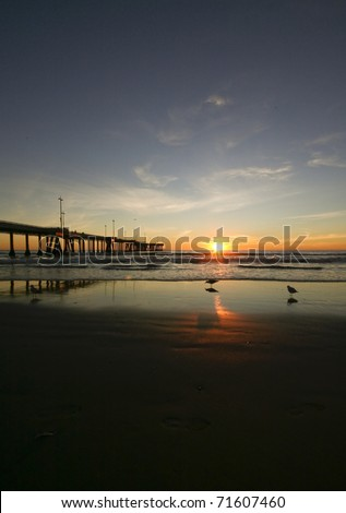 Sunset Reflections at the pier - stock photo
