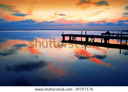 sunset reflections in the lake - stock photo
