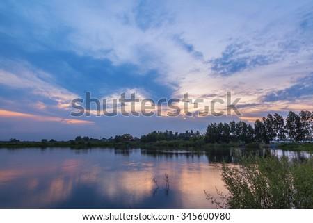 Sunset reflex on the lake  - stock photo