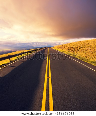 Sunset Road, Mountain Road into Dramatic Sunset - stock photo