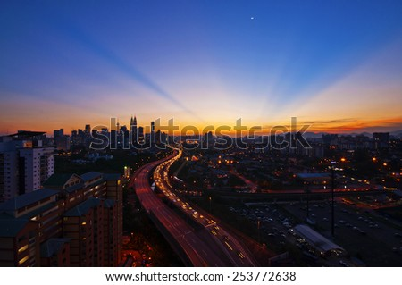 Sunset ROL at Kuala Lumpur and High view, KLCC, Malaysia Image has grain or blurry or noise and soft focus when view at full resolution.  (Shallow DOF, slight motion blur) - stock photo