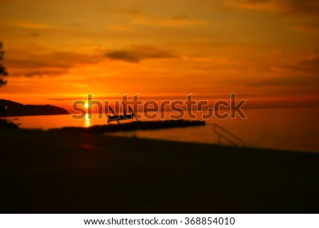 Sunset. Romantic sunset. Sunset Adriatic sea, Izola Slovenia. Beautiful sunset. Sunset  sea beach. Sea sunset blur. Orange sunset. Sunset scene sea. Sunset sea background. Sunset silhouette sea view - stock photo