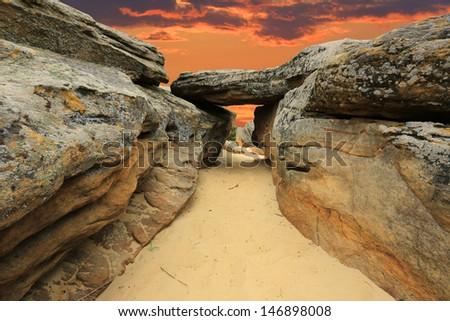 sunset scene in stone desert - stock photo