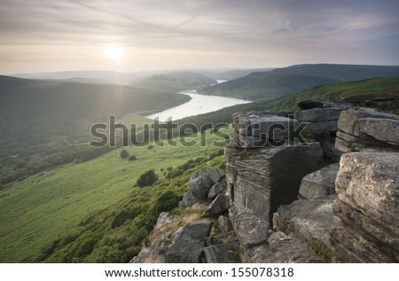 sunset scene looking down valley from bamford edge mountain in the peak district - stock photo