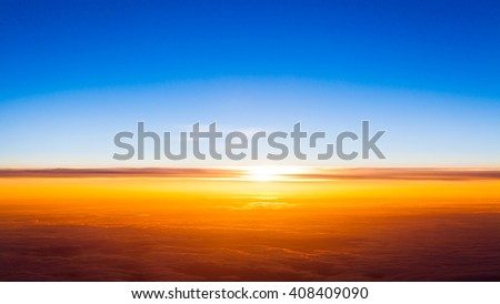 Sunset scene. Sunset above the clouds - stock photo