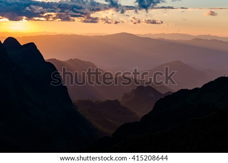 Sunset scene with silhouette mountain at Doi Luang Chiang Dao, Chiang Mai Province, Thailand