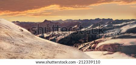 sunset scenery in the austrian alps, winter wonderland - stock photo