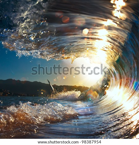 sunset sea curly breaking wave shining in sunlight - stock photo