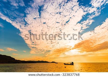 Sunset, sea, landscape. Okinawa, Japan, Asia. - stock photo