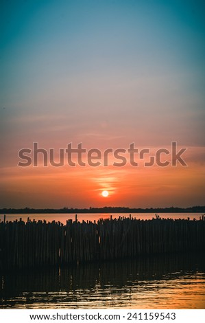 sunset sea with blurry foreground