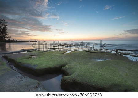 Sunset seascape for background. image contain soft focus and blur due to long expose.