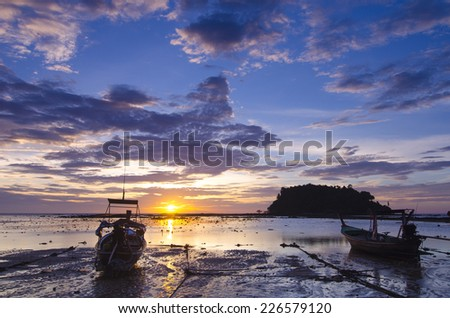Sunset Seascape with fishing boat