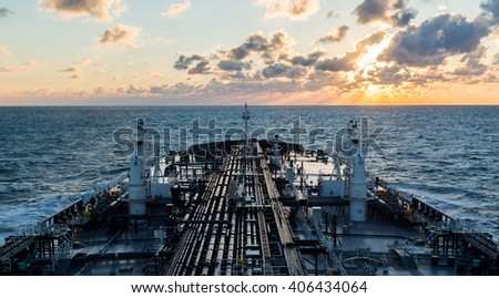 Sunset seascape with tanker deck - stock photo