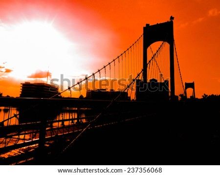Sunset silhouette Bridge - stock photo