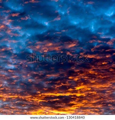 sunset sky an clouds with dramatic light. colorful sky background. - stock photo