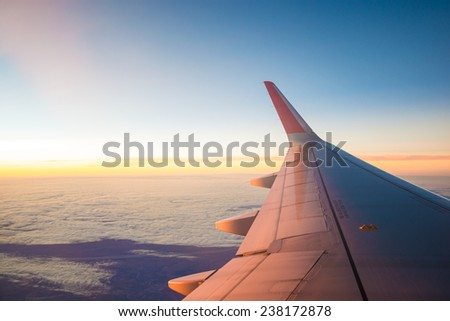 Sunset sky and cloud background, view from airplane - stock photo