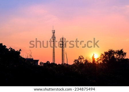 sunset sky and cloud with silhouette antenna - stock photo