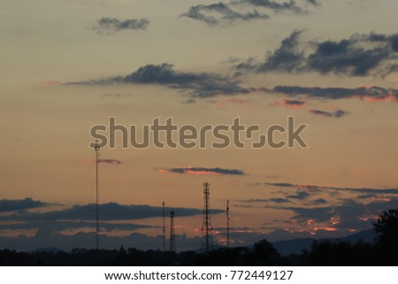 Sunset sky and cloud with silhouette telecommunication antenna.