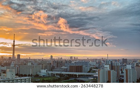 Sunset sky and skyscrapers of Tokyo downtown - stock photo