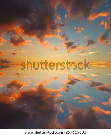 Sunset sky and water reflection