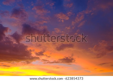 Sunset sky background with hazy drifting clouds