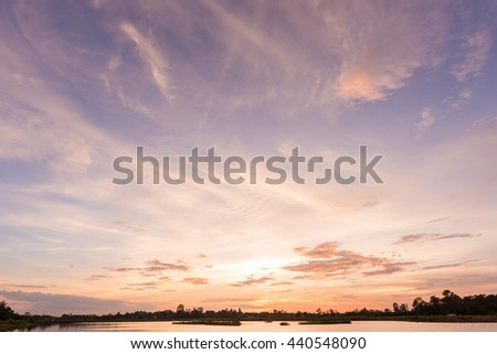 Sunset sky background with landscape of calm lake at sunset  - stock photo