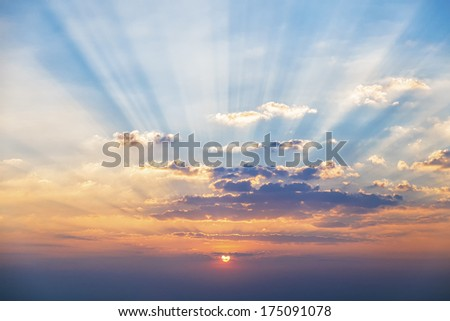 Sunset sky, beam as yellow and blue - stock photo