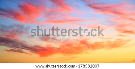 sunset sky only with pink clouds and orange and blue sky