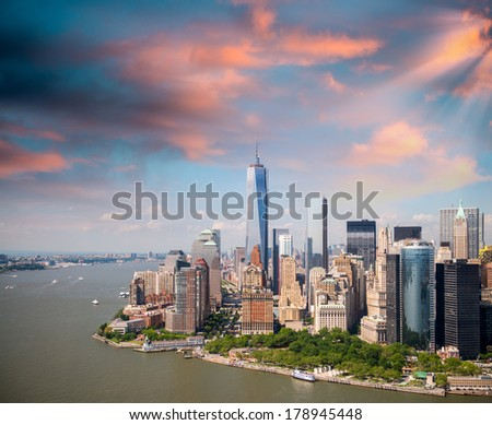 Sunset sky over Lower Manhattan, aerial view from helicopter - stock photo