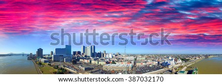 Sunset sky over New Orleans. Aerial view of city and river. - stock photo