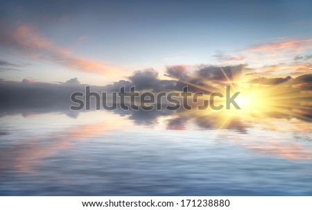 Sunset sky reflected over water