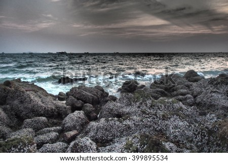 sunset sky sea stone background with dramatic tone