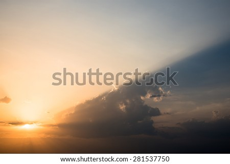 sunset sky with beam of light in evening - stock photo