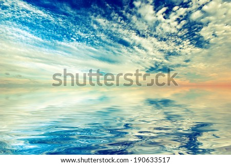 Sunset sky with beautiful clouds and sea. Vintage style