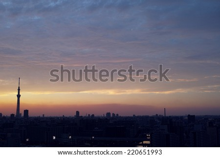 Sunset sky with clouds and silhouette of skyscrapers of Tokyo, the capital of Japan