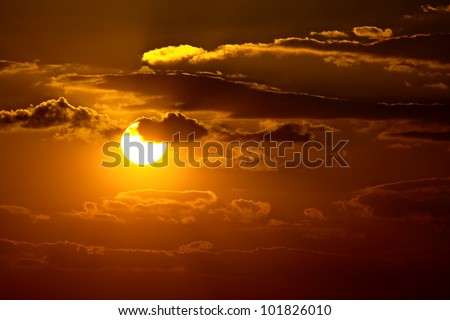 Sunset sky with clouds and sun - stock photo