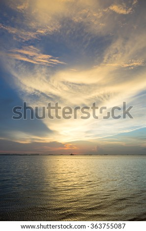 Sunset sky with sea view and boats