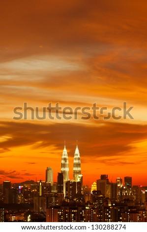 Sunset skyline of Kuala Lumpur city with Petronas Twin Towers or Kuala Lumpur City Centre (KLCC) as part of the skyline. - stock photo