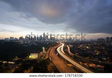 Sunset skyline of Kuala Lumpur city with Petronas Twin Towers or Kuala Lumpur City Centre (KLCC) as part of the skyline during sunset - stock photo