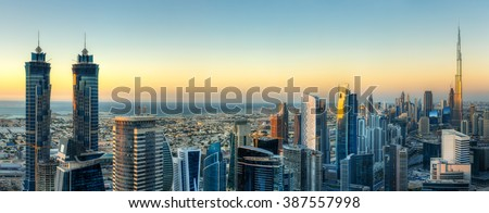 Sunset skyline with modern skyscrapers in Dubai, UAE. Aerial  view of business bay's architecture.