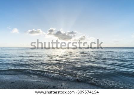 Sunset, sunbeam, sky, sea, beach. Okinawa, Japan, Asia. - stock photo