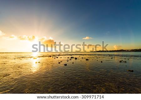 Sunset, sunbeam, sky, sea, coast. Okinawa, Japan, Asia. - stock photo