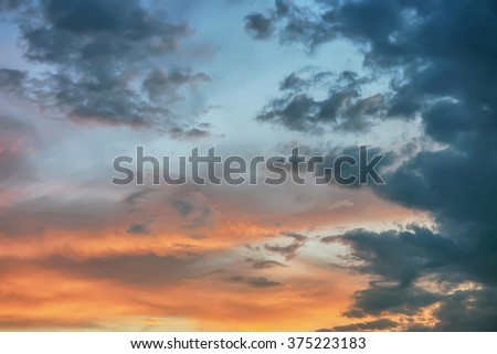 Sunset / sunrise in the sky with storm clouds