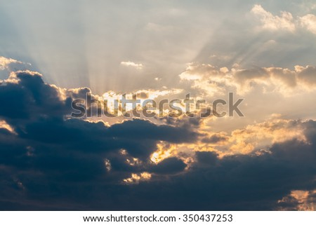 Sunset / sunrise , light rays with clouds.