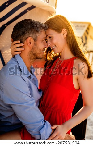 sunset sunrise romantic scene of young adults - stock photo