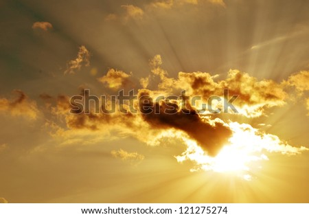 Sunset / sunrise with clouds, light and rays. - stock photo