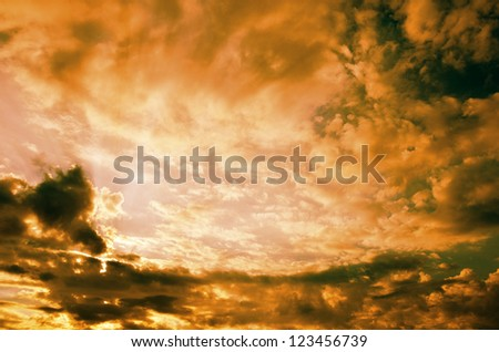 Sunset / sunrise with clouds, light and rays.