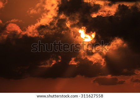 Sunset / sunrise with clouds, light rays.